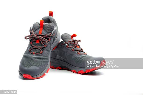 sports shoes against white background - gray shoe stock pictures, royalty-free photos & images