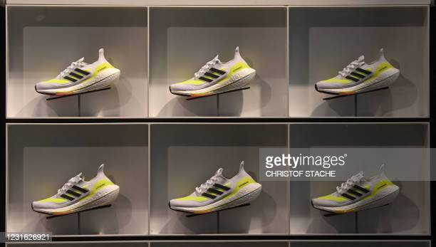 Sports shoes are on display in a store of German sports equipment maker Adidas on March 10, 2021 in Munich, southern Germany. - German sportswear...