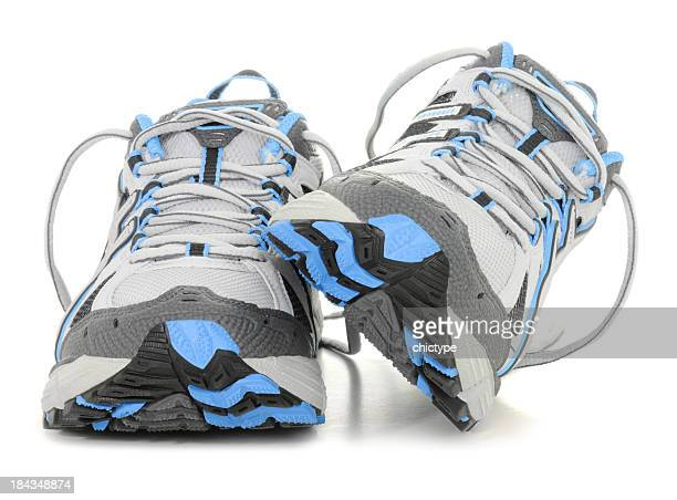 Sports shoes in white and blue colors