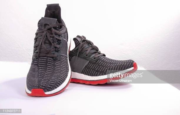 sports shoes of black color on a white background. - gray shoe stock pictures, royalty-free photos & images