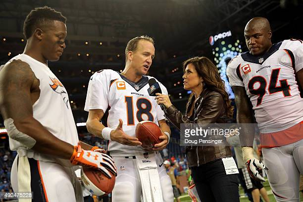 Sports sideline reporter Michele Tafoya interviews quarterback Peyton Manning of the Denver Broncos along with wide receiver Demaryius Thomas and...