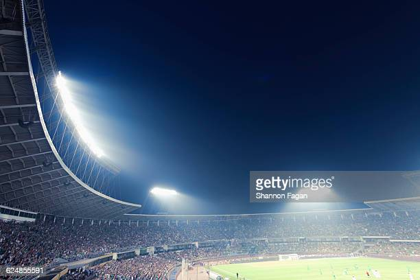 sports stadium arena game at night - stadium stock pictures, royalty-free photos & images