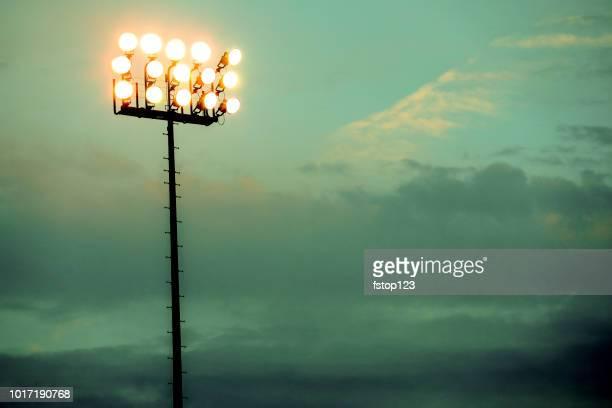 sports stadium lights at dusk, night. - baseball stadium stock pictures, royalty-free photos & images