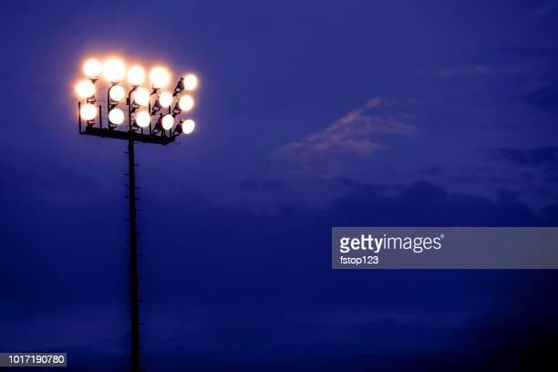 sports stadium lights at dusk, night. - stadium lights stock photos and pictures