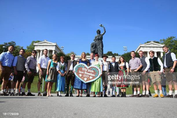Sports stars and Guests pose at the BMW Wiesn Sport Stammtisch Oktoberfest 2013 at Kaefers Wiesn Schaenke Theresienwiese on September 24 2013 in...
