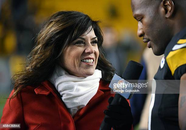 Sports Sunday Night Football sideline reporter Michele Tafoya interviews linebacker James Harrison of the Pittsburgh Steelers after a game against...