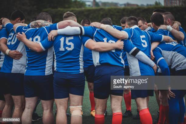 sports team embracing - rugby stock pictures, royalty-free photos & images