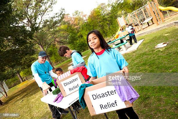 sports team of children collecting donations for disaster victims. volunteers - disaster relief stock photos and pictures