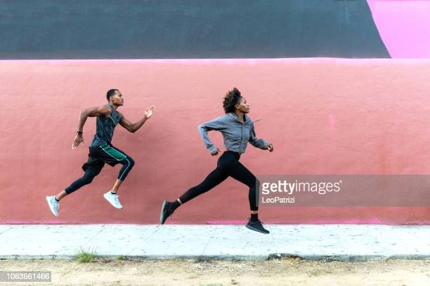 sports team running in the city. group of people getting fit - track event stock pictures, royalty-free photos & images