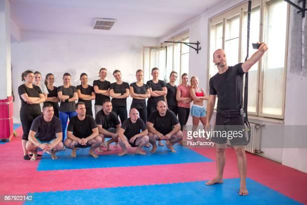 Sports team taking selfie in a gym