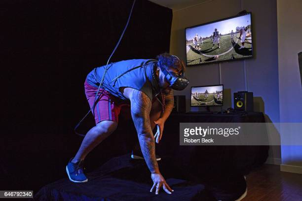 NFL Draft Preview Portrait of former Washington State nose tackle Robert Barber using STRIVR virtual reality headset during photo shoot at STRIVR Lab...