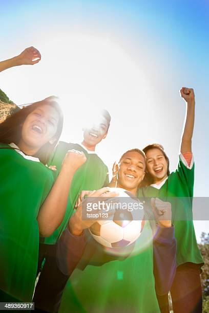 sports: teenage friends soccer team cheers a victory. - football team stock pictures, royalty-free photos & images