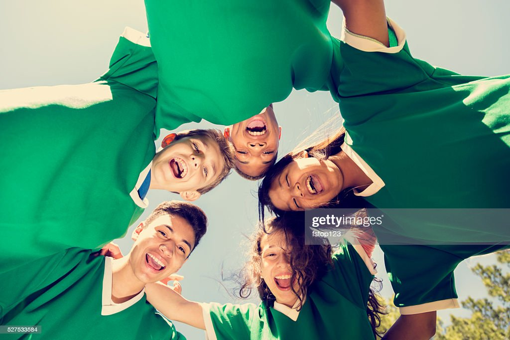 Sports: Teenage friends soccer team with sky, park background. : Stock Photo