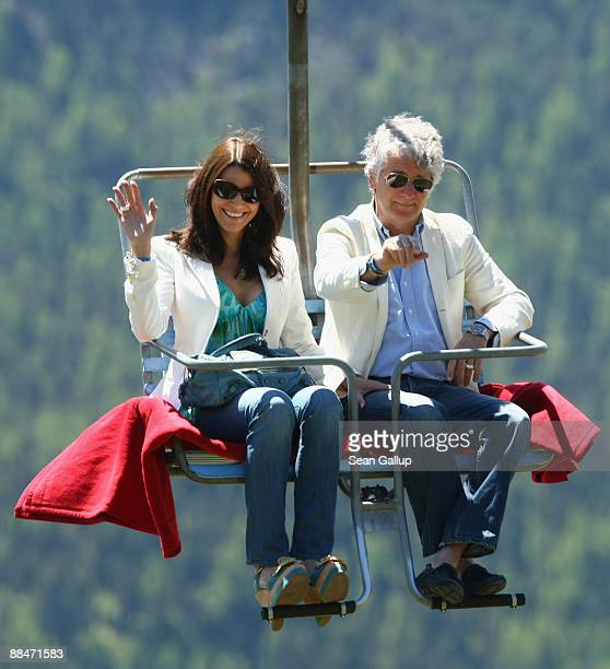 Sports television presenter Marcel Reif and his partner Marion Kiechle ride a ski lift to the wedding brunch reception of former tennis star Boris...