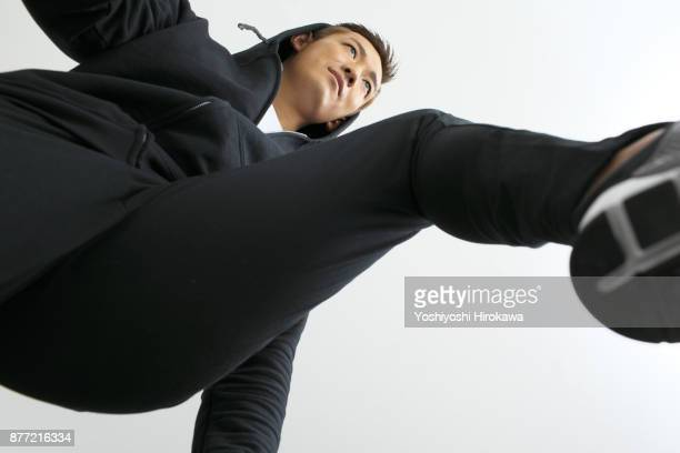 sports trainer young man jumping - low angle view stock pictures, royalty-free photos & images