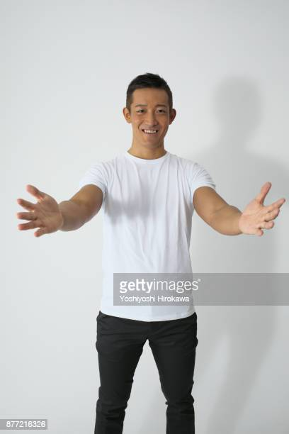 sports trainer young man's portrait - arms outstretched stock pictures, royalty-free photos & images