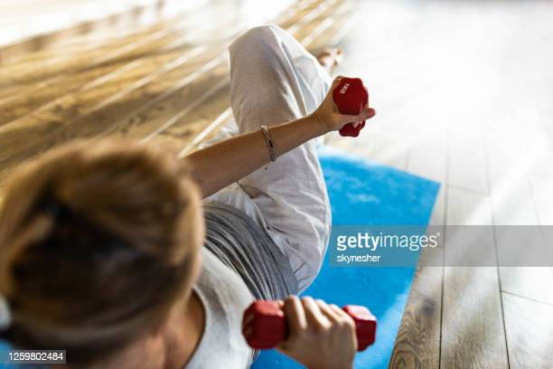 sports training at home! - hand weight stock pictures, royalty-free photos & images