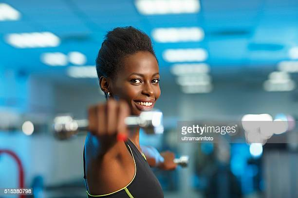 Sports training  Fitness Woman at the gym lifting dumbbells