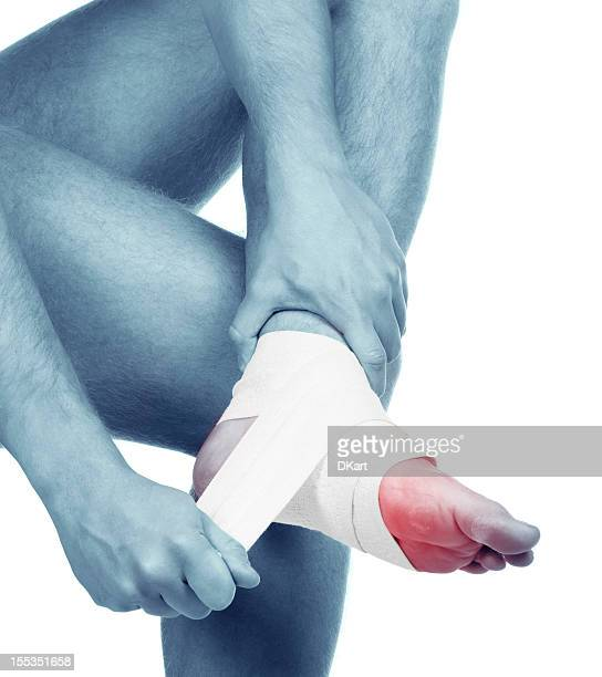 sports trauma of a foot. sprained ankle - elastic bandage stock photos and pictures