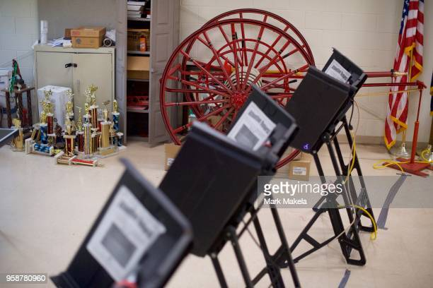 Sports trophies and an antique fire hose are seen behind voting booths at the Hazleton Southside Fire Station polling station for the 2018...