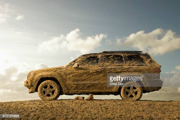 Sports utility vehicle covered in mud