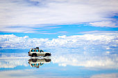 Sports Utility Vehicle driving in the Salar de Uyuni