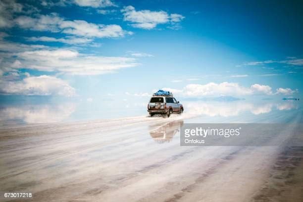 sports utility vehicle driving in the salar de uyuni - february stock pictures, royalty-free photos & images