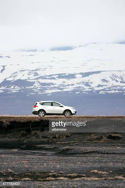 Sports Utility Vehicle, Icelandic road, mountainous backdrop