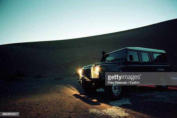 Sports Utility Vehicle On Dessert