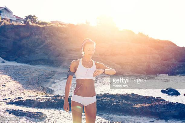 Sports woman at the beach ready for workout