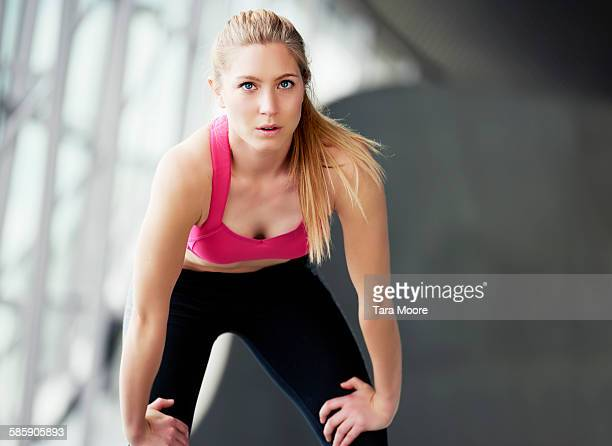 sports woman bending looking determined