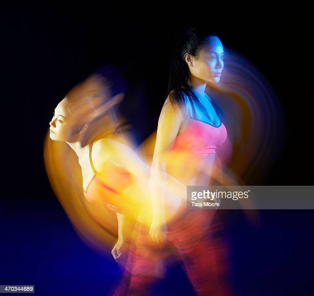 sports woman exercising with motion blur