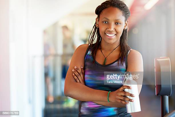 Sports woman in gym clothes in urban gym setting