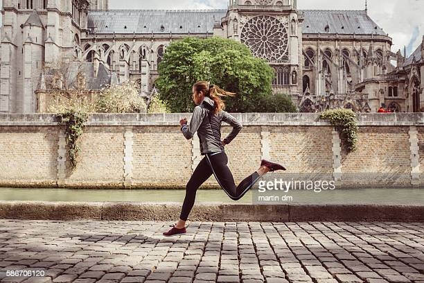 Sports woman jogging in Paris