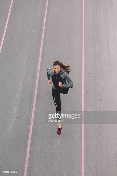 Sports woman jogging outside