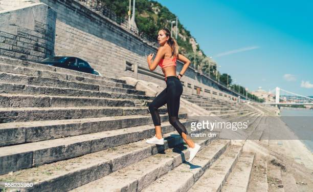 Sports woman jogging upstairs