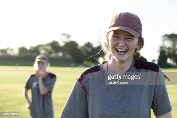 sports woman laughs looking into lens - sport of cricket stock pictures, royalty-free photos & images