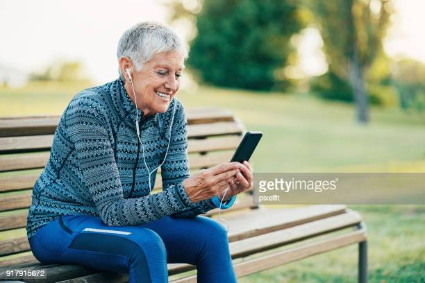 Sports woman listening music from her phone