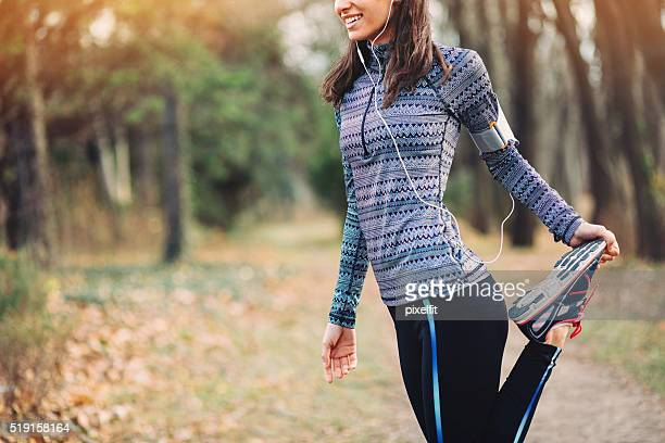 Sports woman stretching in the park