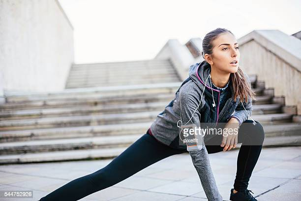 Sports woman stretching outdoors