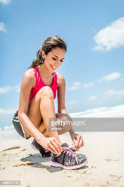 Sports woman tying her shoes