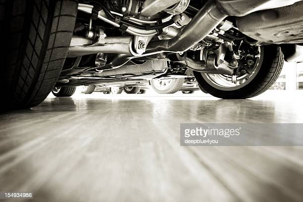 sportscar technik from below - garage stock pictures, royalty-free photos & images