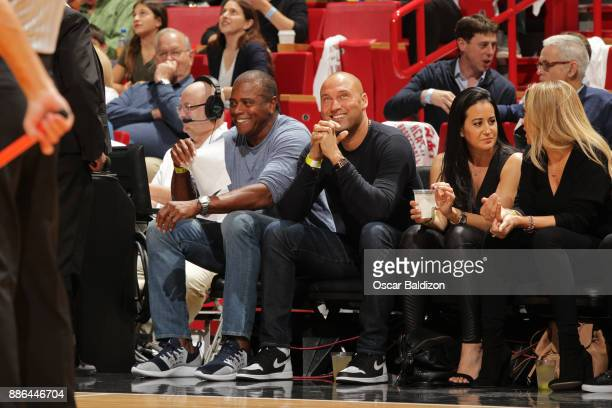 Sportscaster Ahmad Rashad and MLB Legend Derek Jeter attend the Golden State Warriors game against the Miami Heat on December 3 2017 in Miami Florida...