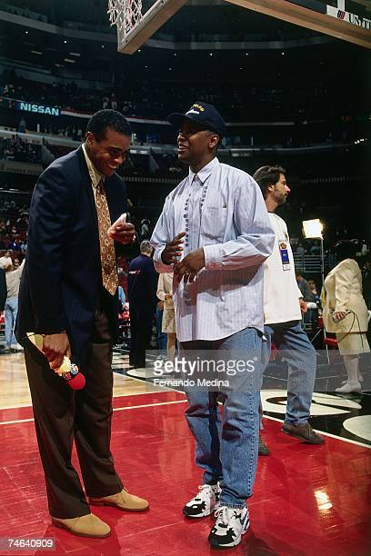 Sportscaster Ahmad Rashad has a laugh with actor Denzel Washington before a 1996 NBA game NOTE TO USER User expressly acknowledges that by...