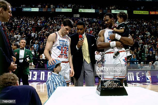 Sportscaster Ahmad Rashad interviews 1993 NBA AllStar CoMVPs John Stockton and Karl Malone of the Western Conference on February 21 1993 at the Delta...