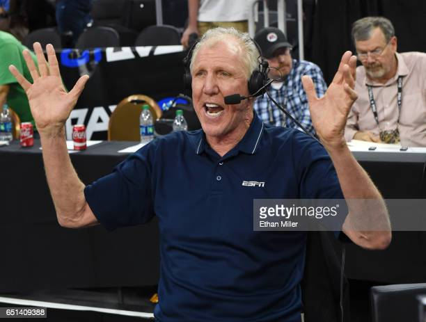 Sportscaster and former NBA player Bill Walton broadcasts after a quarterfinal game of the Pac12 Basketball Tournament between the USC Trojans and...