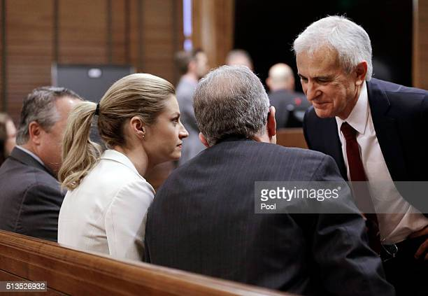 Sportscaster and television host Erin Andrews second from left talks with her attorneys including Bruce Broillet right March 3 in Nashville Tennessee...