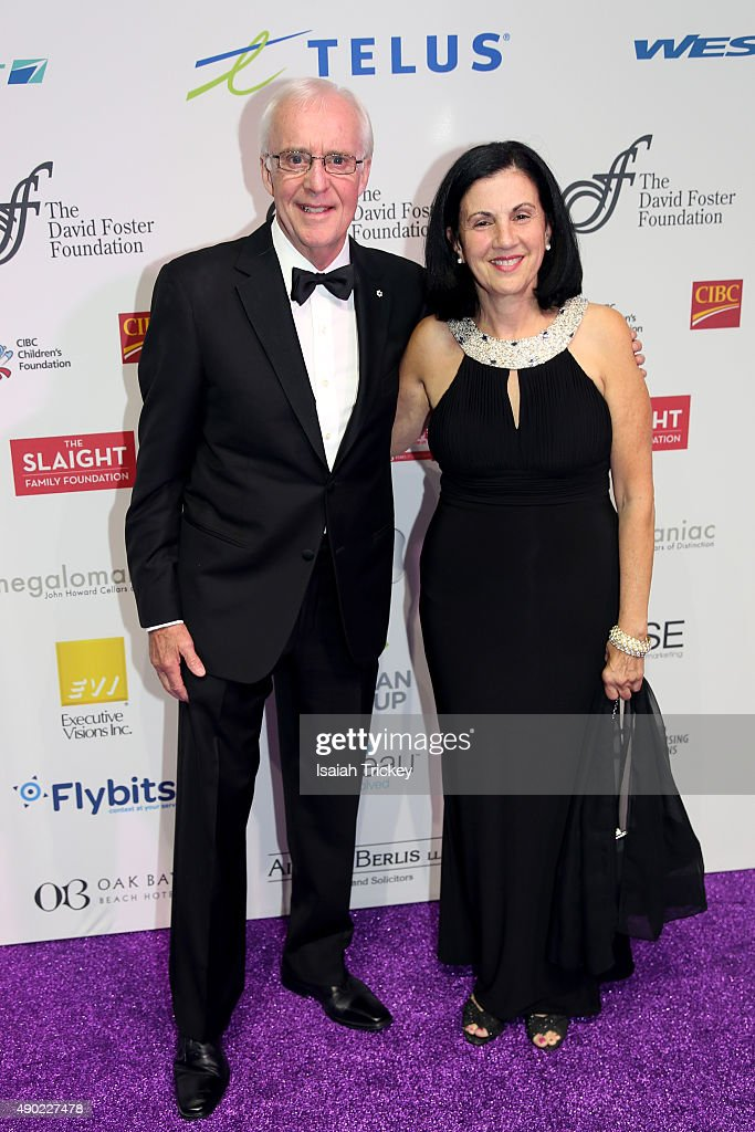 Sportscaster Brian Williams and guest arrives at the David Foster Foundation Miracle Gala And Concert at Mattamy Athletic Centre on September 26, 2015 in Toronto, Canada.