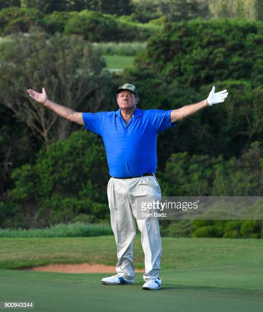 Sportscaster Chris Berman acknowledges fans after playing a shot on the ninth hole during the ProAm round for the Sentry Tournament of Champions at...