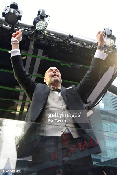 Sportscaster Ernie Johnson entertains the crowd outside of the arena before the game between the Toronto Raptors and Milwaukee Bucks during Game Four...